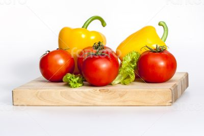 Large paprika of yellow color and red tomatoes