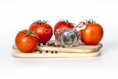 Red juicy tomatoes and black pepper