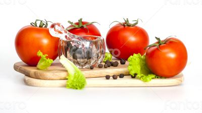 Red juicy tomatoes and lettuce leaves