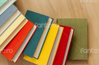 Vintage books in multi-colored covers on a table