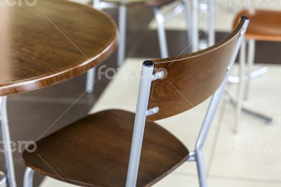 Tables and chairs in cafe in shopping center