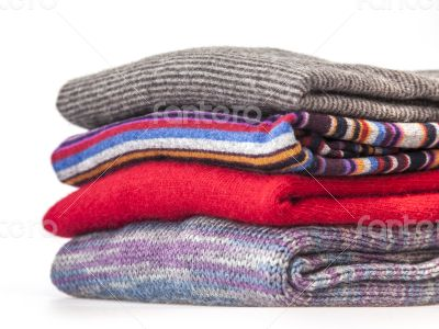 Pile of cashmere products on a counter