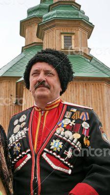 Ukrainian cossack general under wooden church
