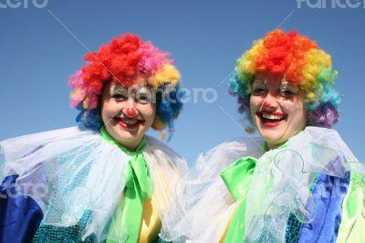 Two bizarre clowns in colored wigs