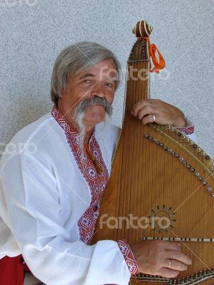 Senior ukrainian musician kobzar with bandura