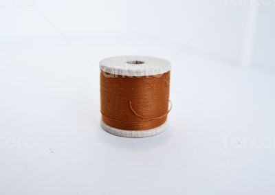 Brown spool of thread