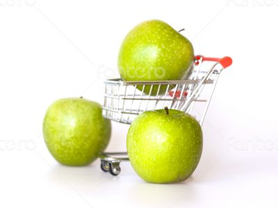 Large green apples in the cart for shopping