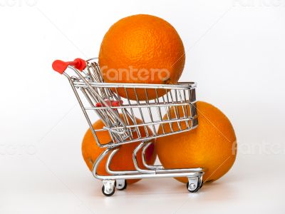 Large bright oranges in the cart for shopping