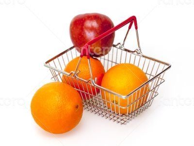 Bright large oranges in a basket for shopping