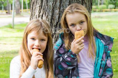 Cute two eating girls