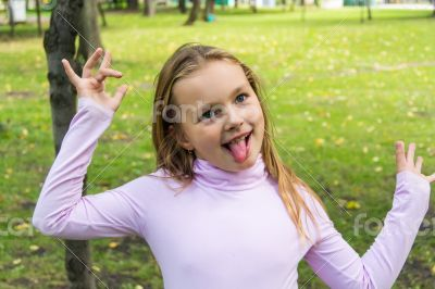 Cute girl with put out tongue