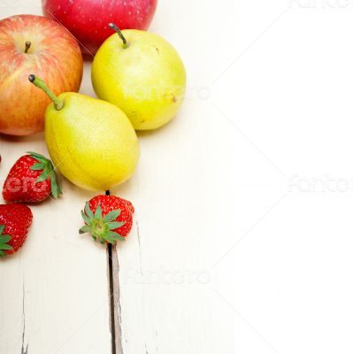 fresh fruits apples pears and strawberrys