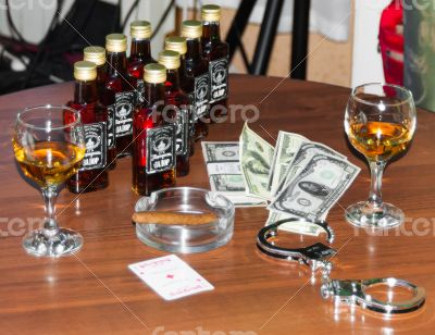 money and glass of whiskey