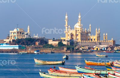 Arabian see, fishing harbour, boats and mosque