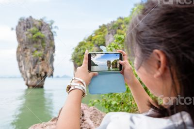 Women tourist shooting view by mobile phone