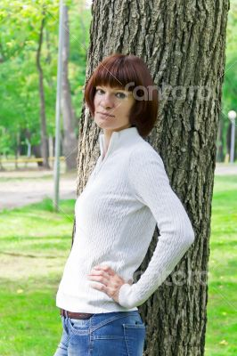 Woman with brown hair near tree