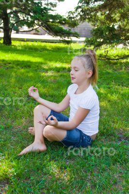 Cute girl in lotus pose