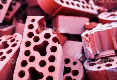 Pile of new but beaten silicate bricks