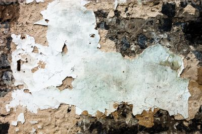 The wall texture with the damaged plaster