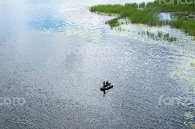Two fishermen in the rubber boat
