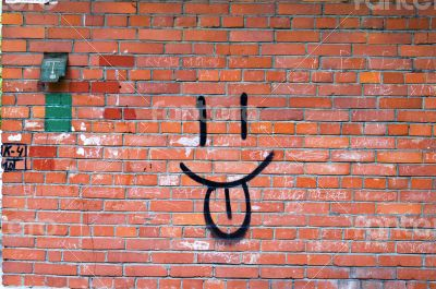 Brick Wall and Smile Graffiti