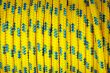 Heap of yellow and blue plastic ropes