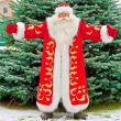 Full Length Portrait of Santa Claus standing with open hands out