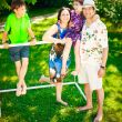 Artistic lifestyle photo of full happy family laying relaxed on